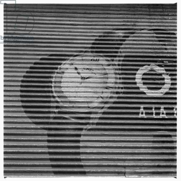 Image of a rollershutter shopfront with Omega watch advert, Paris early early 1950's