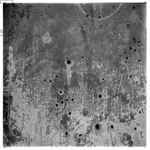 Image of a wall riddled with bullet holes, Paris, early early 1950's