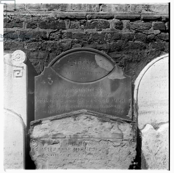 Tombstones in St. Anne's Churchyard, Limehouse, mid 1950's (b/w photo)