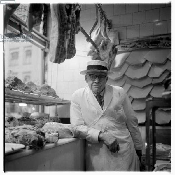 Butcher in Soho - Slater & Cooke, Disney & Jones, portrait of a butcher in butchers shop called Slater & Cooke, Disney & Jones, Brewer Street Soho London, mid 1950's (b/w photo)