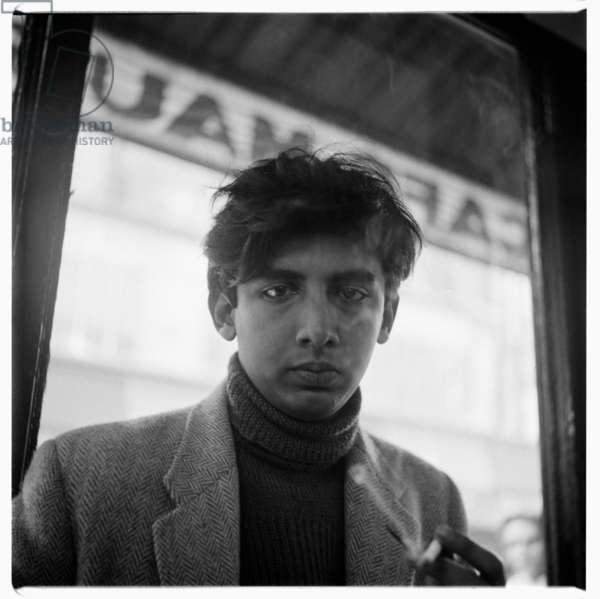 Portrait of poet Dom Moraes in Soho pub, London, mid early 1950's (b/w photo)