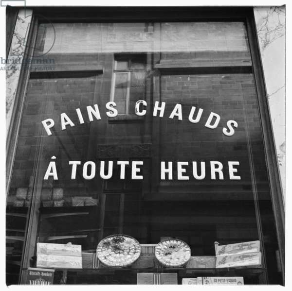 "Image of shop window '""Pains Chauds a Toute Heure"" - Hot bread available all day, Paris early early 1950's"