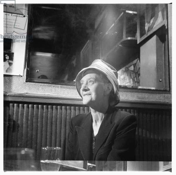 Elaine Bigland, portrait of author and travel writer Eileen Bigland being interviewed by Dan Farson in a Soho pub, London early 1960's (b/w photo)