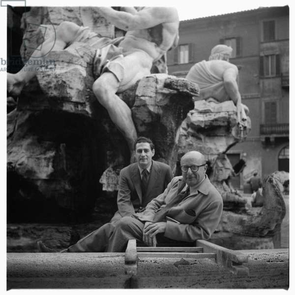 Portrait of two unknown men standing in front of the Fountain of the Four Rivers, Fontana dei Quattro Fiumi, Rome, Italy, early early 1950's