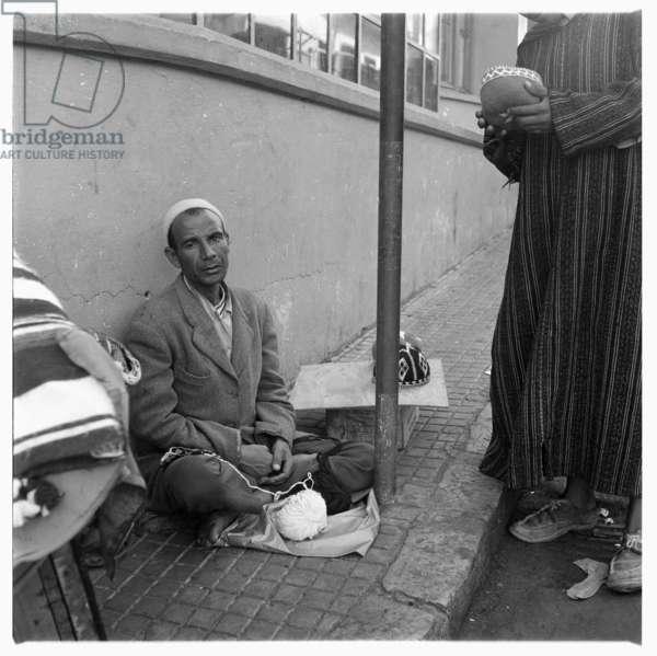 Street scene, beggar on the street, Tangier, early 1960's (b/w photo)
