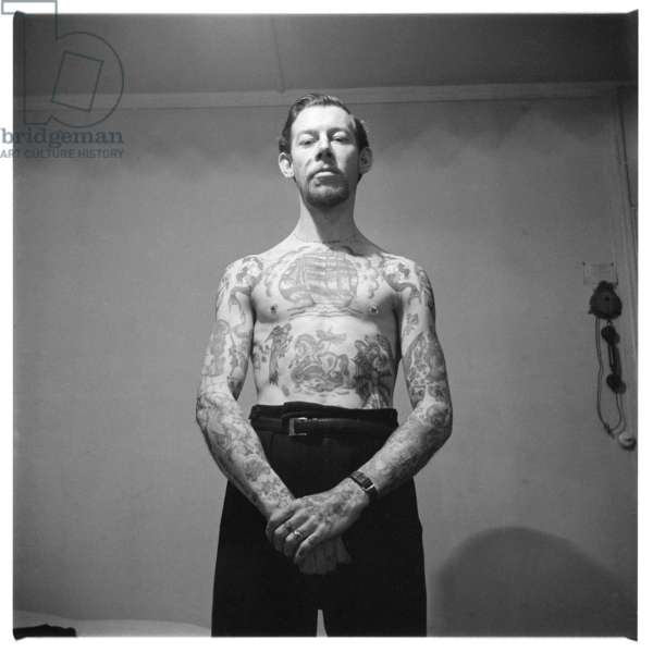 Cash Cooper's tattooed chest and arms, c.1955 (b/w photo)
