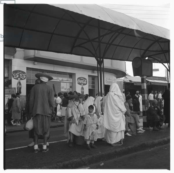 People gathered outside a cafe, Tangier, early 1960's (b/w photo)