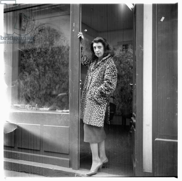Soho woman, portrait of unknown woman wearing leopardskin fur coat, Soho doorway, London late 1950's (b/w photo)