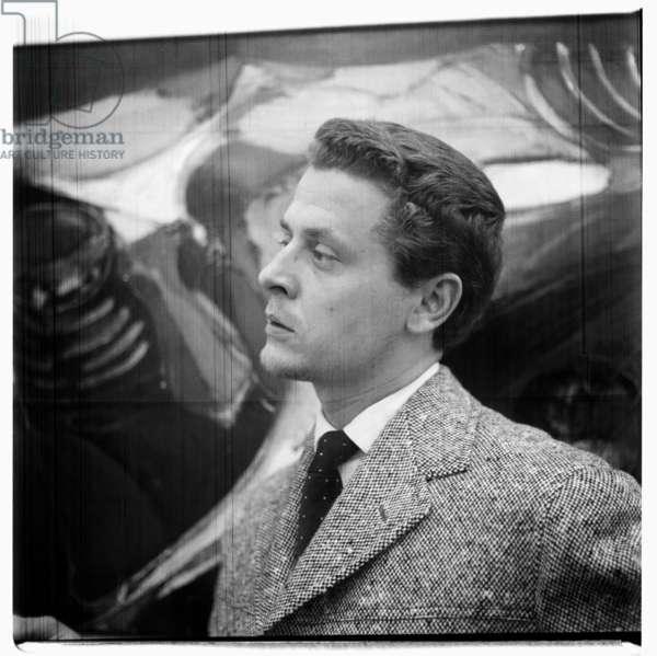 Unknown man in Paris gallery, c.1955 (b/w photo)