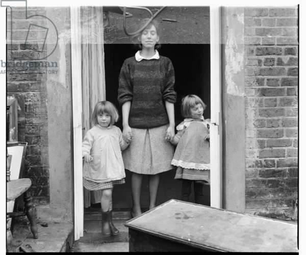 Janet Behrens with her children, portrait of wife of artist Timothy Behrens at home in Britain possibly late 1950's (b/w photo)