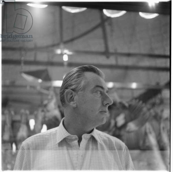Peter Lacy, portrait of former WW2 fighter pilot, lover and model of Francis Bacon, Smithfirld meat market, London, UK, mid 1950's (b/w photo)