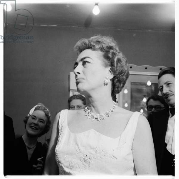 Joan Crawford (actress), portrait of Hollywood actress Joan Crawford at a press conference, London, UK, mid 1950's (b/w photo)
