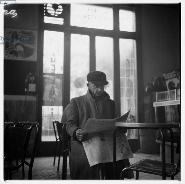 Image of a man reading the newspaper, Il Messaggero Cronaca di Roma, Rome café, early 1950's