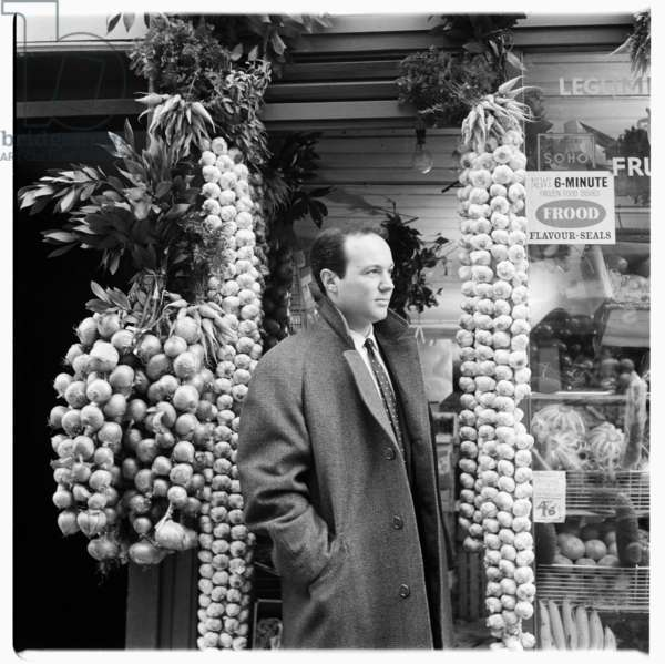 """Ted, portrait of man called """"Ted"""" standing outside Continental Stores, unknown details, London early 1960's (b/w photo)"""