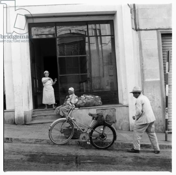 A bicycle outside a shop front, Tangier, early 1960's (b/w photo)