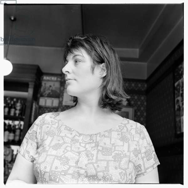 Henrietta Moraes, portrait of model and muse Henrietta Moraes in a bar, Soho London late 1950's (b/w photo)