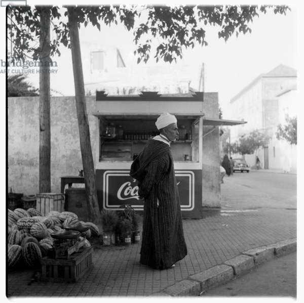A man selling watermelons by the side of the road, Tangier, early 1960's (b/w photo)