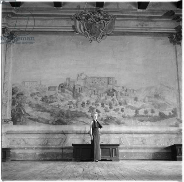Caresse Crosby, portrait of American patron of the arts and inventer of first patented brassiere, in Castello di Rocca Sinibalda, Italy, mid 1950's (b/w photo)