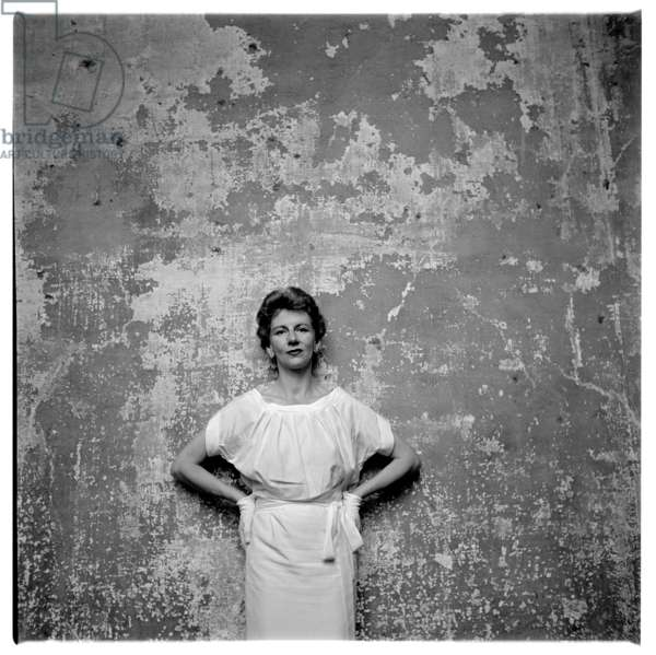 Woman in front of wall, c.1955 (b/w photo)