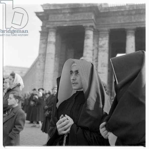 Portrait of a young beatific nun, large wimple, slight moustache, St. Peters Square, Rome early early 1950's