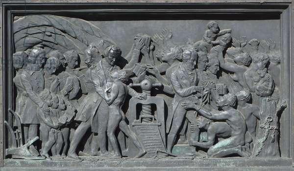 Strasbourg, Bas-relief of the sculpture of Gutenberg. Africa