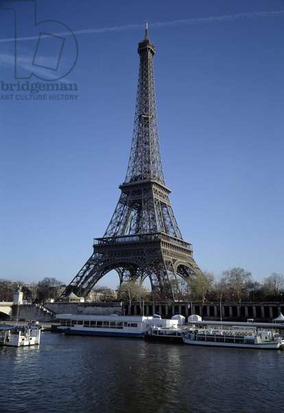 Architecture: view of the Eiffel Tower made by architect Gustave Eiffel (1832-1923) in Paris.