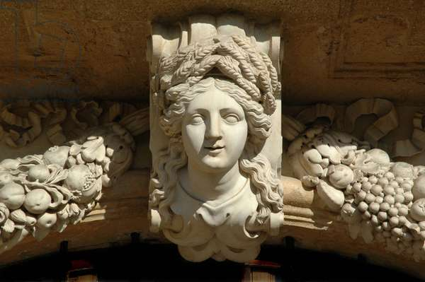 Architecture: presume portrait of Lucrece de Forbin, mistress of the Duke of Vendome. It is depicted in Ceres (Demeter), goddess of fertility, covered by a crown of cobs and surrounded by a garland of fruit. Detail of a sculpture of the Pavillon de Vendome built by architect Antoine Matisse and decorated by sculptors Pierre Pavillon and Jean Claude Rambot for the Duke of Vendome. 1665-1668. Aix en provence (Bouches du Rhone)