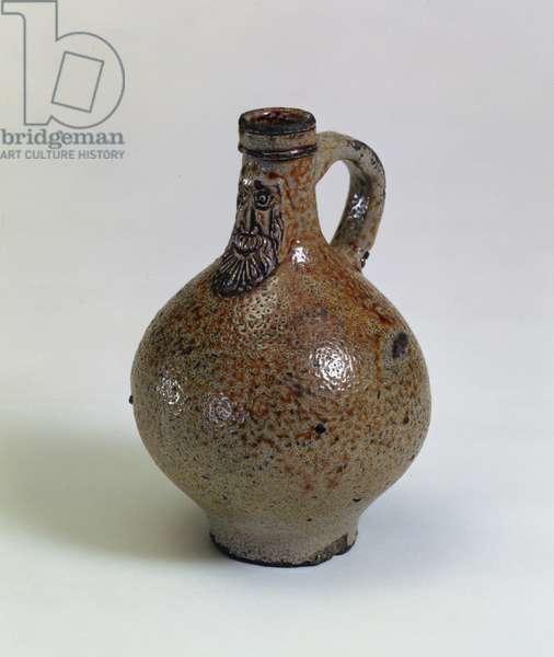 Bartmannkrug or Bellarmine wine bottle decorated with an applied bearded face mask, Germany, c.1630-40 (salt-glazed stoneware)
