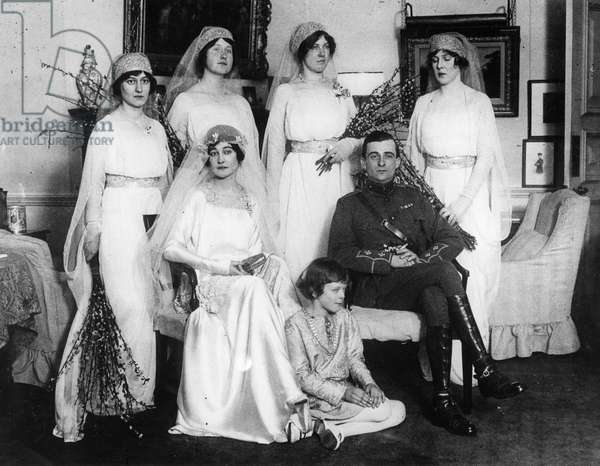 Bride and bridegroom with bridesmaids and train bearers (b/w photo)