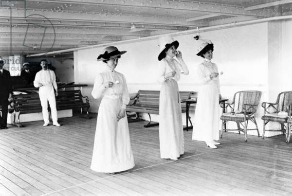 Egg and Spoon Race on board, out bound, 1911 (b/w photo)