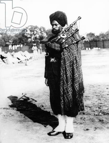 Sikh Regimental Piper, 1900 (b/w photo)