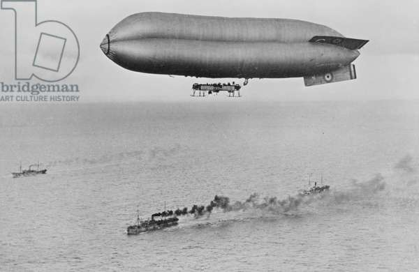 RNAS Coastal Class Airship C23A Flying above a Warship Convoy, c.1917 (b/w photo)