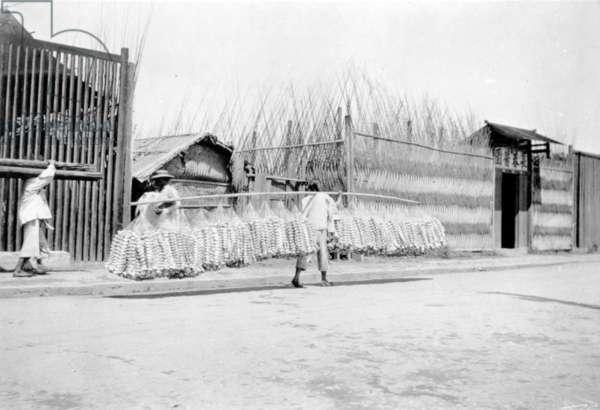 A Joss Paper Seller, China, c.1905-10 (b/w photo)