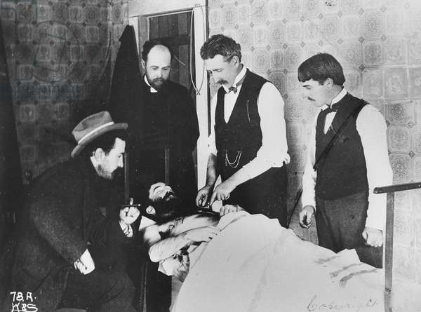 A dead man in a doctor's surgery, from 'One Man's Gold Rush: A Klondike Album' by Murray Cromwell Morgan (b/w photo)