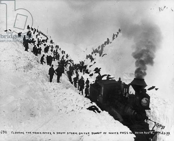 Clearing the track after a snow storm on the summit of White Pass and Yukon Route, from 'One Man's Gold Rush: A Klondike Album' by Murray Cromwell Morgan, 20th March, 1899 (b/w photo)