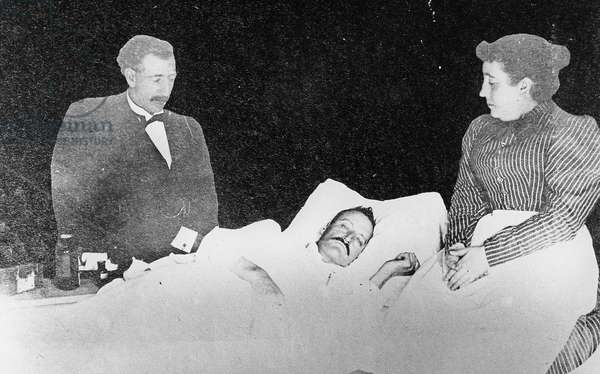 A sick man in bed, from 'One Man's Gold Rush: A Klondike Album' by Murray Cromwell Morgan (b/w photo)