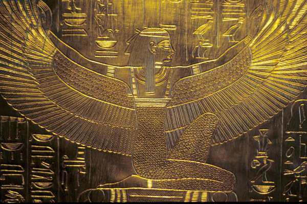 Winged goddess and inscription on feet of Tutankhamun's coffin Egypt