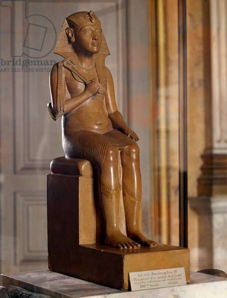 Egyptian antiquite: gypsum statue of the ruler Akhenaton or Amenhotep IV or Amenophis IV (1353-1337 BC). 18th dynasty. Dim. 0,64x0,17m. Paris, Louvre Museum