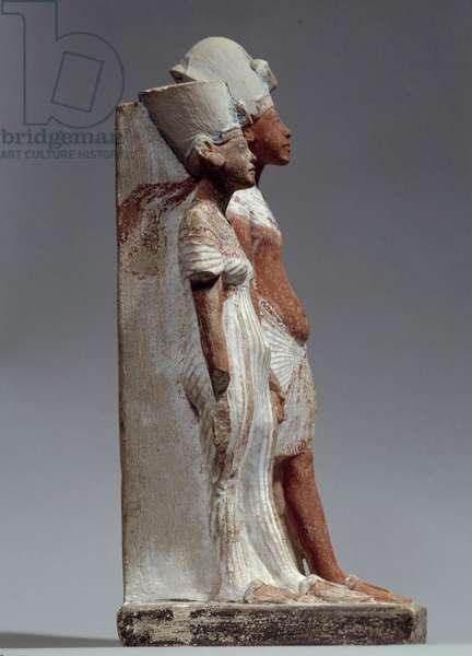 Ancient Egypt Art: King Akhenaton and Queen Nefertiti. Painted limestone sculpture made around 1360 BC Paris, Musee Du Louvre