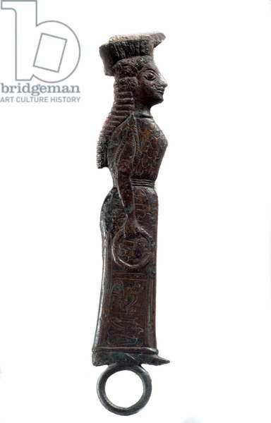 Greek art: bronze mirror handle depicting a woman of profile. Archaic period. Sun 0,18 m Paris, Musee du Louvre