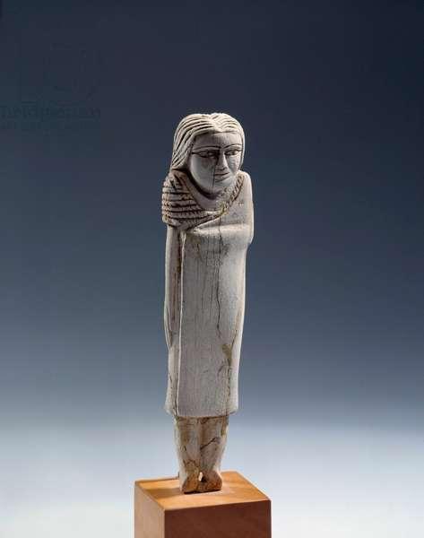 Egyptian antiquite: feminine ivory statuette. Period thinitis (3100-2700 BC) Sun. 0,13 m Paris, musee du Louvre