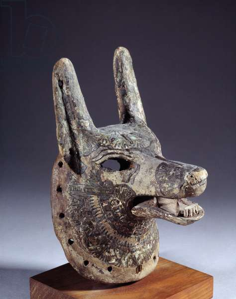 Ancient Egyptian: wooden dog mask representing Anubis (or Qebehsenouf). 19th dynasty (1295-1186 BC). Sun 0,19 m Paris, Musee du Louvre