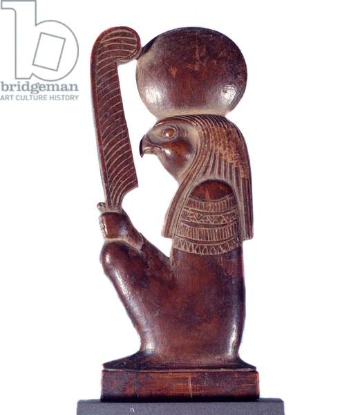 Art Egypt: the god Re squatting holding the pen of Maat. Wooden sculpture, New Empire (circa 1550-1069 BC). Paris, Musee Du Louvre
