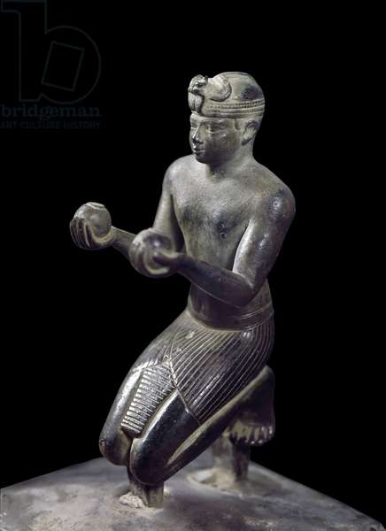 Egyptian antiquitis: statue of Nubian king Taharqa (Taharka) making the offering of wine to the god hawk Hemen. Detail of the sculpted group. Low period (664-332 BC), 25th dynasty. Paris, Louvre Museum