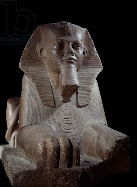 Egyptian antiquitis: the Great sphinx usurp by Ramses II and his son Mineptah. Pink granite sculpture. Paris, Louvre Museum.