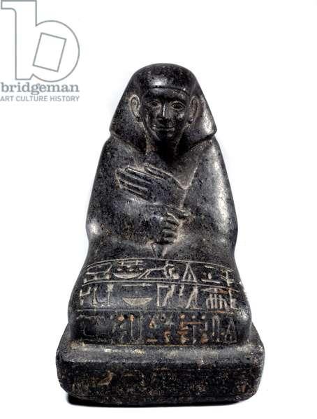 Egyptian antiquite: sculpture in gabbro representing senior official Senpou. Middle Empire (2033-1710 BC) Paris, Louvre Museum