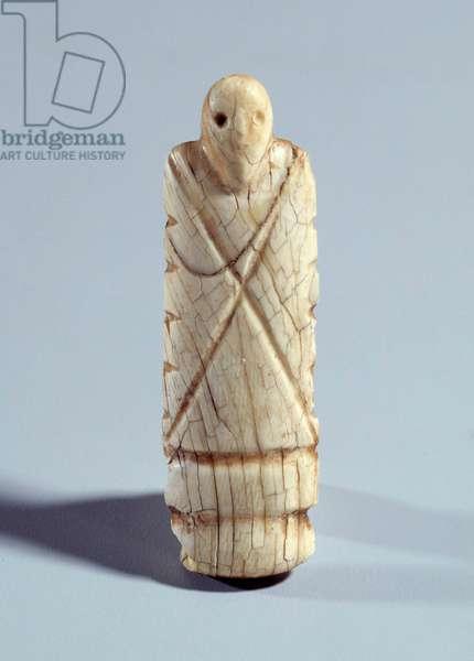 Egyptian antiquite: figurine of bearded ivory man. Period Nagada I (ca. 3800-3500). Paris, Louvre Museum