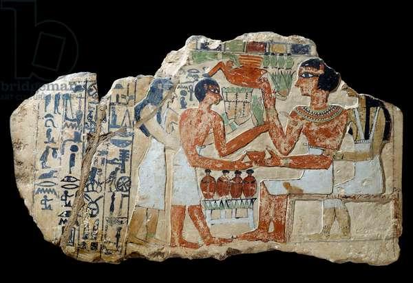 Egyptian antiquite: Iri stele in limestone. A couple making an offering. First intermediate period (2200-2033 BC) Sun. 0,3x0,52 m Paris, musee du Louvre