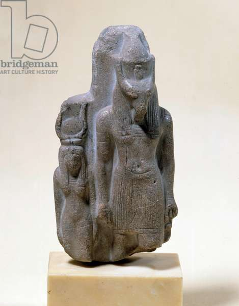 Egyptian antiquite: stone statuette of Seth and his companion Nephthys. Regne of Ramses II (1279-1213 BC). Paris, Louvre Museum