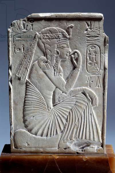 Egyptian antiquite: small limestone stele of Ramses II: the child king sits on the sign of the horizon. 19th dynasty (ca. 1295-1186). Paris, Louvre Museum